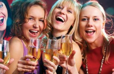 Beautiful women drinking champagne at a party