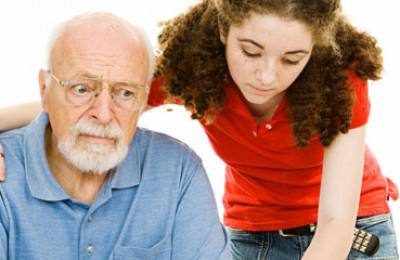 granddaughter helping confused senior man