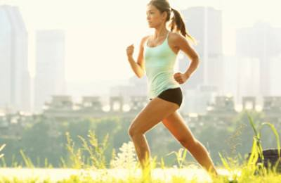 Running woman city fitness